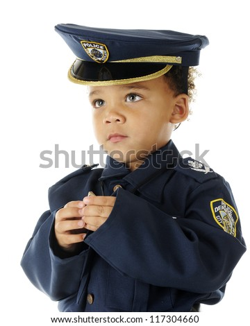 Close-up image of a serious preschool policeman in uniform.  On a white background. - stock photo