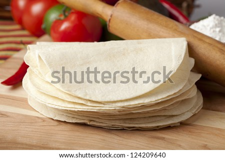 Close-up image of a stack of empty tortilla wrap on the wooden table - stock photo
