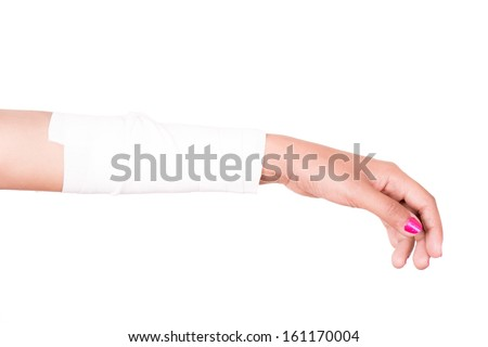Close-up image of a white bandage wrapped on injured arm. - stock photo