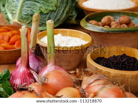 Close-up image of a wooden table full of natural food ingredients. - stock photo