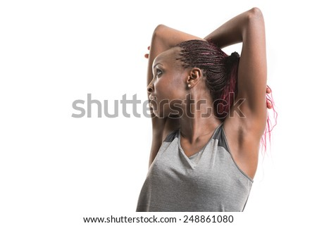 Close up image of african female in sports clothing relaxing and stretching after workout isolated on white background Image with copyspace for text - stock photo