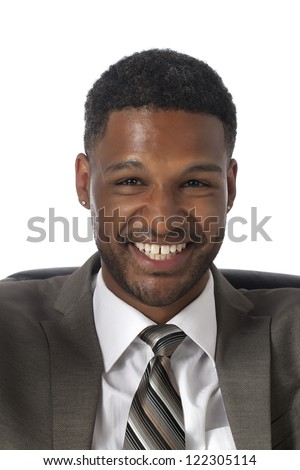 Close-up image of an African-American businessman in business suit smiling over the white background - stock photo