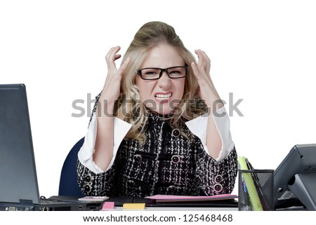Close-up image of an angry female secretary against the white surface - stock photo