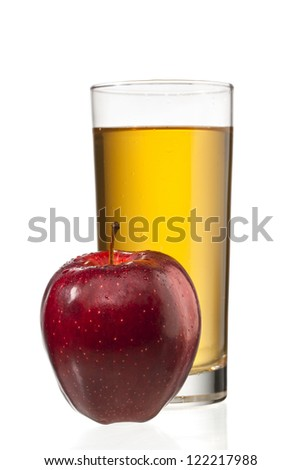 Close-up image of an apples beside a glass of apple juice. - stock photo