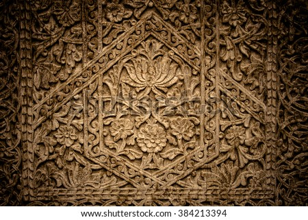 Close-up image of ancient doors with oriental ornaments from Uzbekistan - stock photo