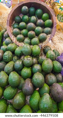 Close up image of avocado in supermarket. Shallow DOF, selective focus. - stock photo