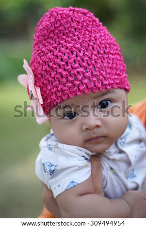 Close up image of beautiful baby. Selective focus on her eyes, shallow DOF