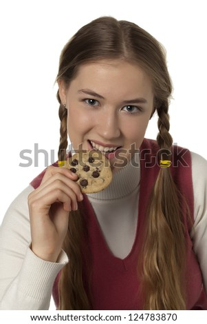 Close-up image of beautiful teenager eating cookies isolated over the white background - stock photo