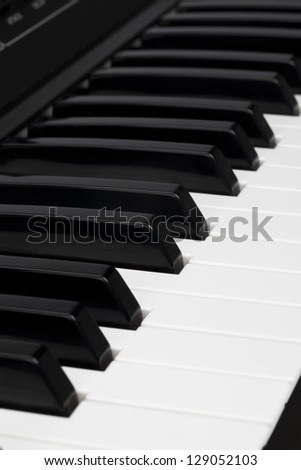 Close-up image of black and white keyboard of a piano