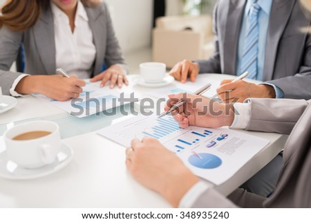 Close-up image of business team discussing financial reports