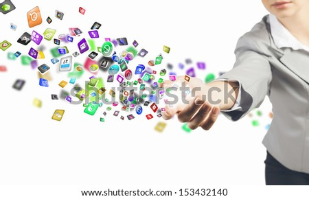 Close up image of businesswoman holding icons in hand - stock photo