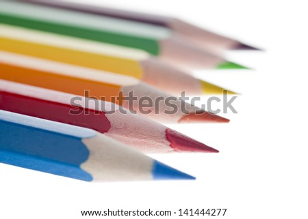 Close up image of colorful pencils against white background