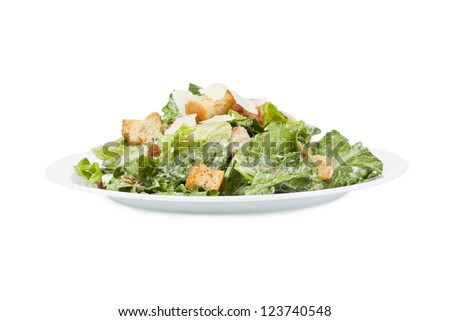 Close up image of delicious ceasar salad in white plate against white background - stock photo