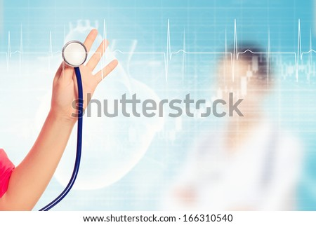 Close-up image of doctor's hand holding stethoscope
