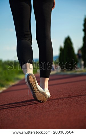 Close Up Image Of Female Fitness Shoes During Training Outside