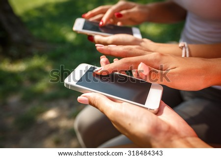 Close up image of female hands using  smart phone.