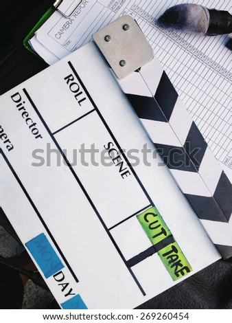 close up image of Film Slate on set - stock photo