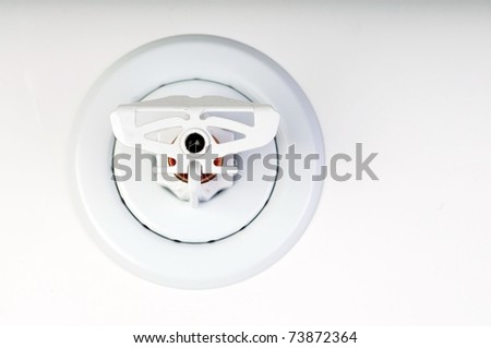 Close up image of fire sprinkler on white