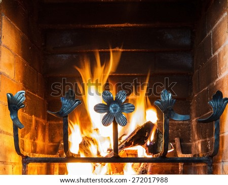 Close up image of fireplace and wood burning .