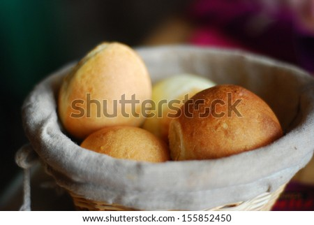 Close up image of freshly baked bread and bread rolls/Bread and rolls in basket - stock photo