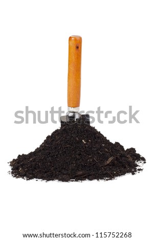 Close up image of garden shovel and soil against white background - stock photo