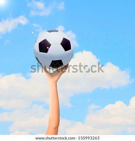 Close-up image of hand holding soccer ball