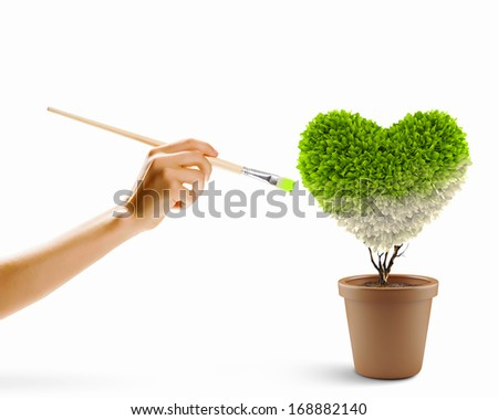 Close up image of hand painting plant heart shaped - stock photo