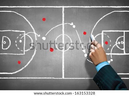 Close up image of human hand drawing football tactic plan - stock photo