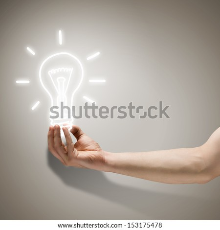 Close up image of human hand holding electrical bulb - stock photo