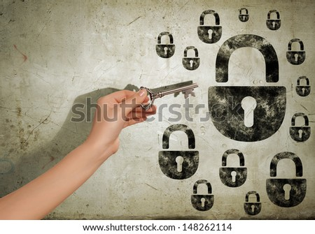 Close up image of human hand holding key - stock photo