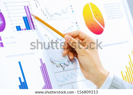 Close up image of human hand holding pencil. Marketing presentation