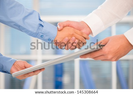 Close-up image of human hands after singing a promising contract - stock photo