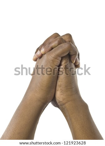 Close-up image of human hands together against the white surface