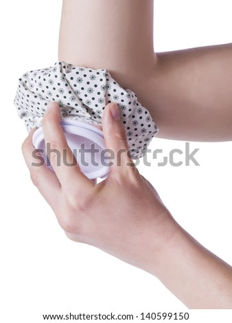 Close up image of ice bag on injured elbow against white background - stock photo