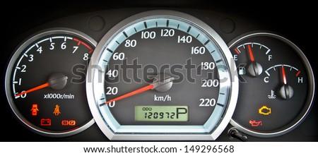 close up image of illuminated car dashboard - stock photo