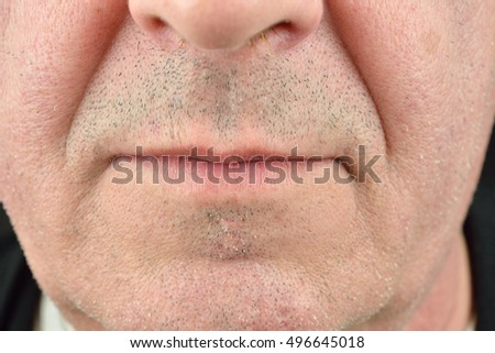 Close up image of lips of a mature man