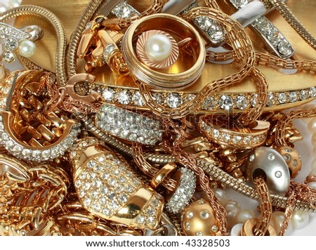 close up image of luxury golden accessories with precious stones - stock photo