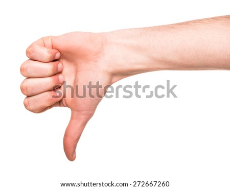 Close-up image of male hand showing thumb down. - stock photo