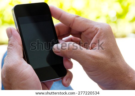 close up Image of man checking his phone - stock photo