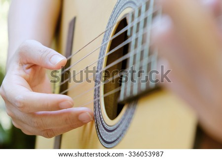 Close up image of Man playing his classic guitar background