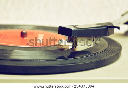 close up image of old record player,  retro filtered . selective focus  - stock photo