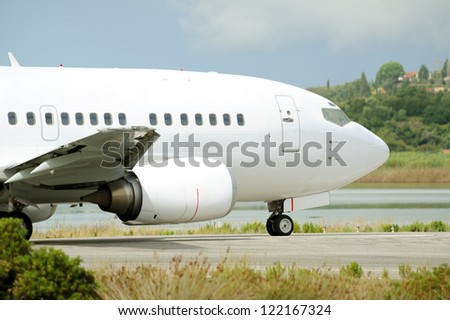 Close up image of passenger airplane on the runway, moments before take-off - stock photo