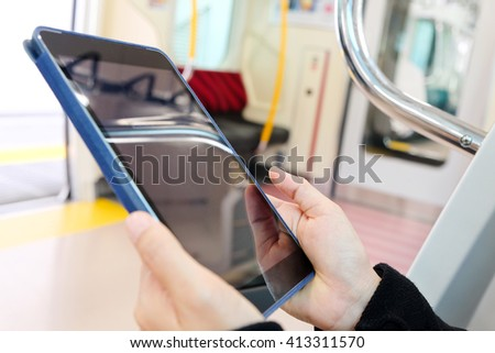 Close up image of  people using digital tablet  in subway train,social media life - stock photo