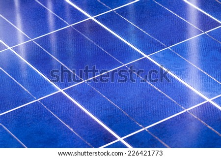 Close Up image of photovoltaic cells with crossing reflections, Selected focus