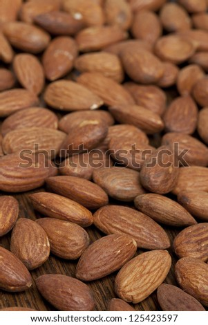 Close up image of pile of almonds