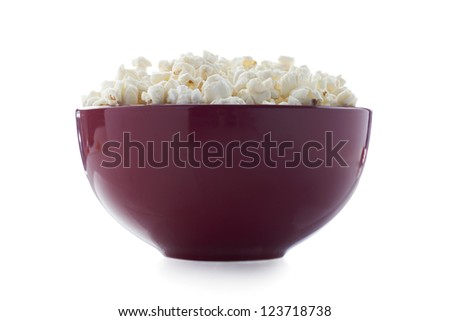 Close up image of popcorn in red bowl against white background - stock photo