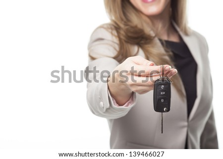 Close up image of property agent holding a key