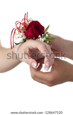Close up image of putting floral bracelet in a woman wrist against white background - stock photo