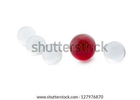 Close-up image of red marbles surrounded by white marbles isolated on - stock photo