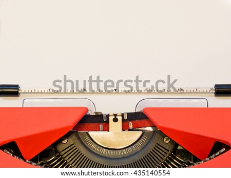 close up image of red typewriter with paper sheet. copy space for your text. retro filtered - stock photo